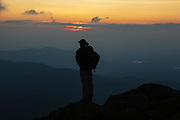 Appalachian Trail - A hiker enjoys the sunset from Mount Clay. Located in the White Mountains, New Hampshire USA.