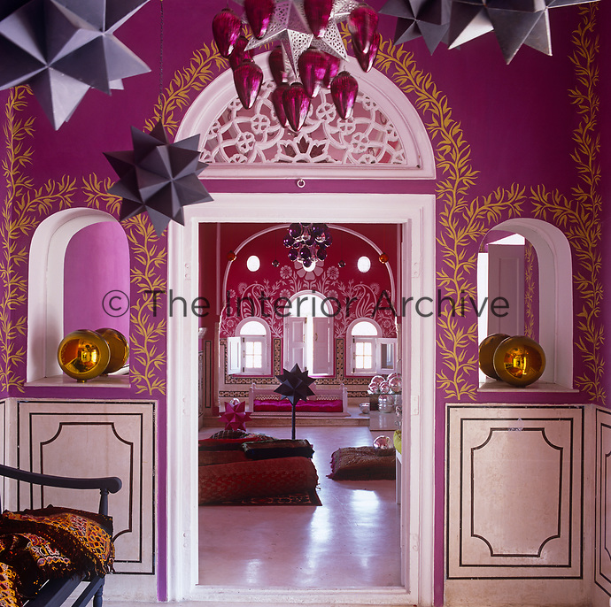 View from the ornately stencilled purple and gold ante-room into the beautiful pink living room