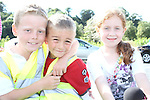 Jack Dawson, Cian Reynolds and Shona Bradley waiting for the Helicopter to arrive at the Garda Station Open Day...Picture Jenny Matthews/Newsfile.ie