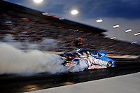 Sept. 17, 2010; Concord, NC, USA; NHRA pro stock driver Rodger Brogdon does a burnout  during qualifying for the O'Reilly Auto Parts NHRA Nationals at zMax Dragway. Mandatory Credit: Mark J. Rebilas/