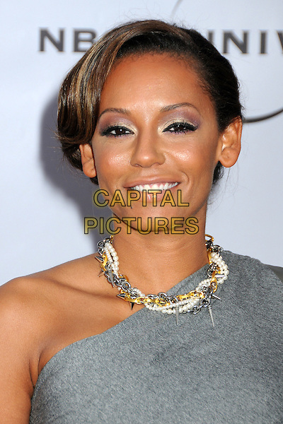 "MELANIE BROWN (MEL B).The Cable Show 2010 ""An Evening with NBC Universal"" held at Universal Studios Hollywood, Universal City, California, USA..May 12th, 2010.headshot portrait chains hair up necklace silver gold daggers pearls eyeliner eyeshadow make-up beauty scary spice grey gray one shoulder .CAP/ADM/BP.©Byron Purvis/AdMedia/Capital Pictures."