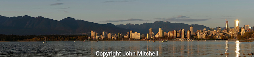 Panorama of English Bay, downtown skyline, Stanley Park, West Vancouver, and North Shore Mountains, Vancouver, BC, Canada