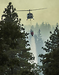 August 20, 2001 Coulterville, California  -- Creek Fire –  CDF helicopter drops water on spot fire on Cuneo Road.The Creek Fire burned 11,500 acres between Highway 49 and Priest-Coulterville Road a few miles north of Coulterville, California.
