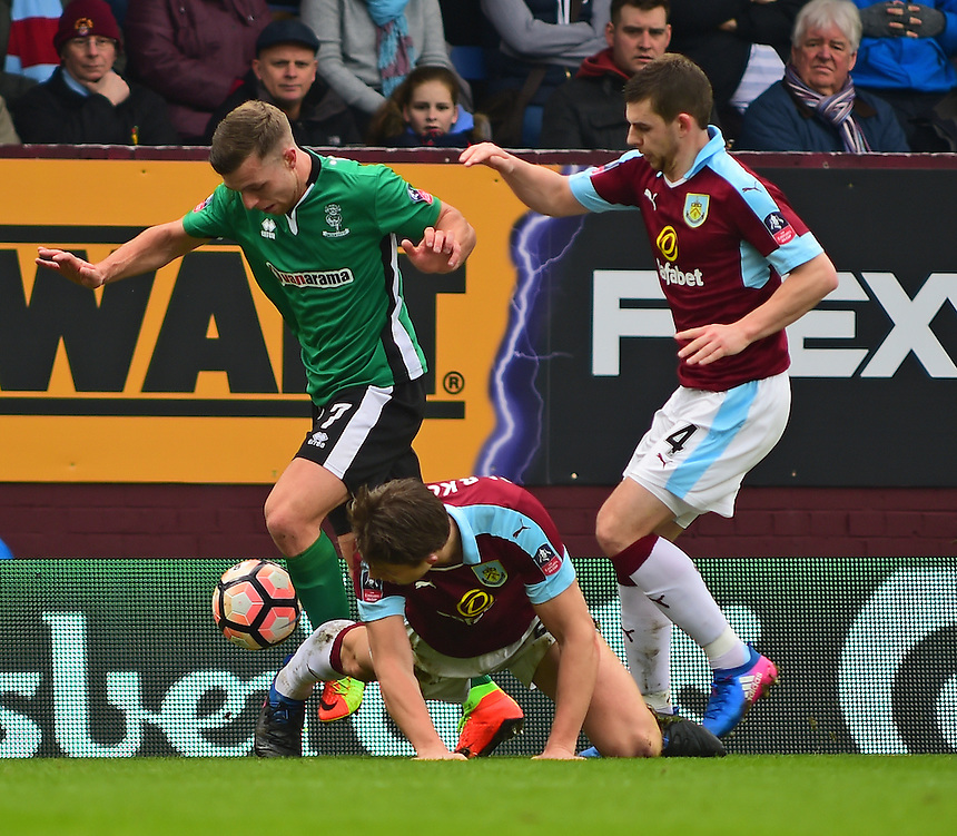 Lincoln City's Jack Muldoon vies for possession with Burnley's James Tarkowski and Jon Flanagan<br /> <br /> Photographer Andrew Vaughan/CameraSport<br /> <br /> Emirates FA Cup Fifth Round - Burnley v Lincoln City - Saturday 18th February 2017 - Turf Moor - Burnley <br />  <br /> World Copyright &copy; 2017 CameraSport. All rights reserved. 43 Linden Ave. Countesthorpe. Leicester. England. LE8 5PG - Tel: +44 (0) 116 277 4147 - admin@camerasport.com - www.camerasport.com