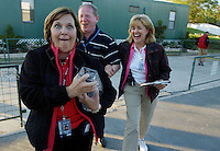 Kelly Jordan/Staff--032606--PGA Tour staff member Norma Long clutches the TPC trophy as she walks to the 18th green with engraver Sean Egan, from Waterford Crystal in Waterford, Ireland, middle and Marion Davis to the trophy presentation area after the name of TPC winner Stephen Ames was engraved on the trophy during the final round of The Players Championship at Sawgrass in Pontre Vedra Beach, Florida Sunday March 26, 2006.(The Florida Times-Union, Kelly Jordan)