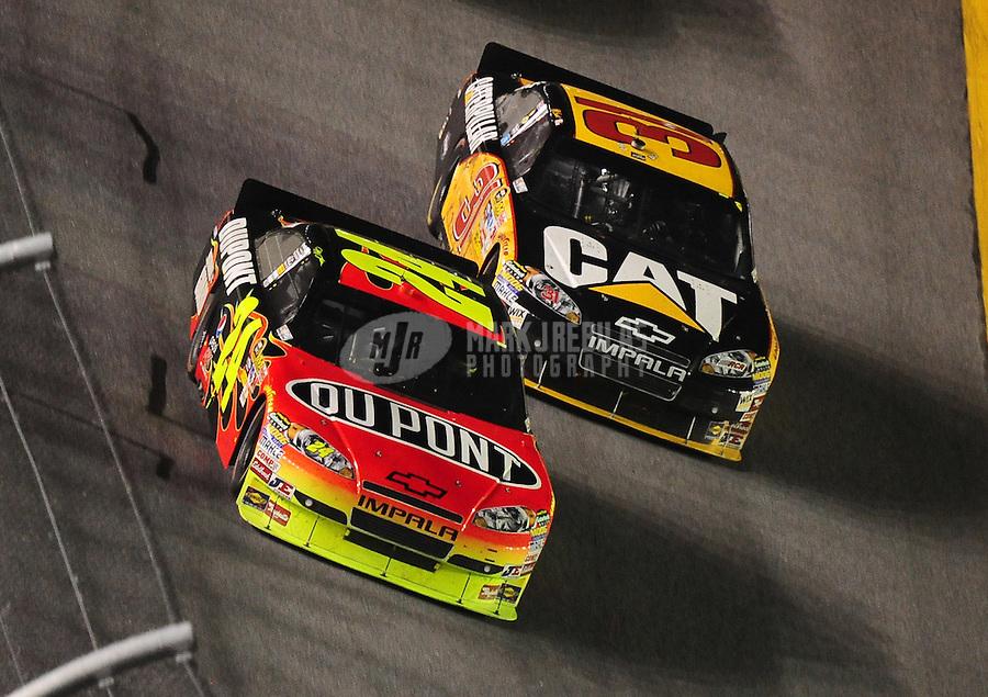 Jul. 3, 2010; Daytona Beach, FL, USA; NASCAR Sprint Cup Series driver Jeff Gordon (24) races alongside Jeff Burton (31) during the Coke Zero 400 at Daytona International Speedway. Mandatory Credit: Mark J. Rebilas-