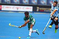 Muhammad Mushtaq of Pakistan rifles his shot past Agustin Mazilli of Argentina during the Hockey World League Quarter-Final match between Argentina and Pakistan at the Olympic Park, London, England on 22 June 2017. Photo by Steve McCarthy.