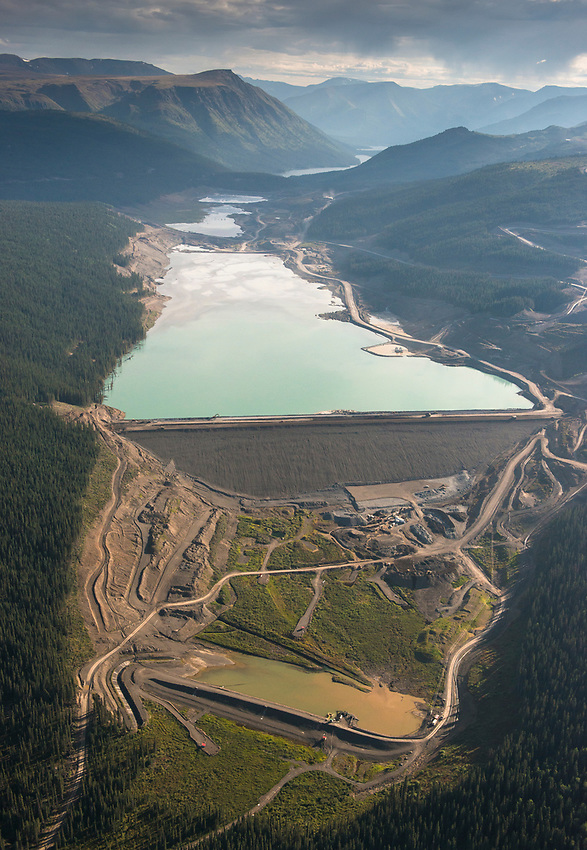 Red Chris Mine. Tailings Pond. view south over north dam and yet uncompleted tailings impoundment...only approx one third constructed.  Northwest B.C., 2017.