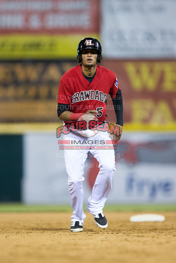 Jairo Beras (5) of the Hickory Crawdads takes his lead off of second base against the Charleston RiverDogs at L.P. Frans Stadium on August 25, 2015 in Hickory, North Carolina.  The Crawdads defeated the RiverDogs 7-4.  (Brian Westerholt/Four Seam Images)
