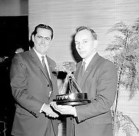 17th December 1957;  London, UK;  World Motor Racing Champion , Jack Brabham  left  congratulates the newly elected BBC TV Sportsman of the Year, Motor Cycle Racing Champion John Surtees who holds his trophy after the presentation ceremony on television last night