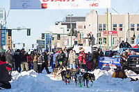 Sebastien Vergnaud and team leave the ceremonial start line with an Iditarider and handler at 4th Avenue and D street in downtown Anchorage, Alaska on Saturday March 4th during the 2017 Iditarod race. Photo © 2017 by Brendan Smith/SchultzPhoto.com.