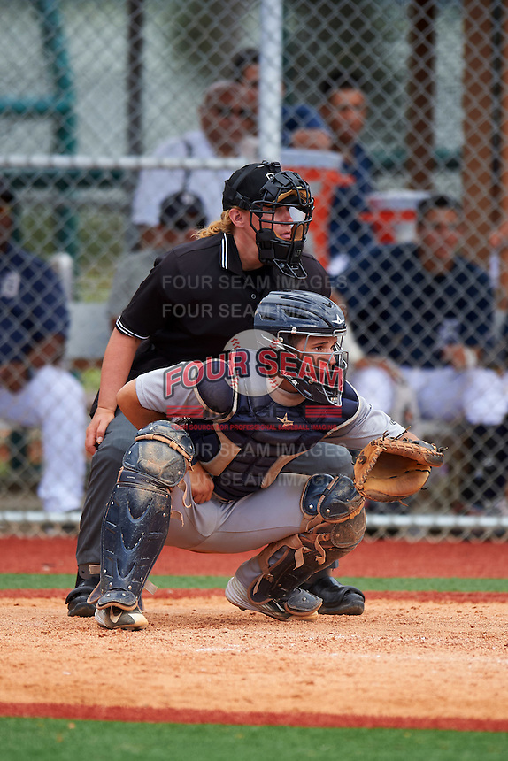 Umpire Jennifer Pawol and GCL Tigers West catcher Andres Sthormes (9) await the pitch during a game against the GCL Tigers East on August 4, 2016 at Tigertown in Lakeland, Florida.  GCL Tigers West defeated GCL Tigers East 7-3.  (Mike Janes/Four Seam Images)