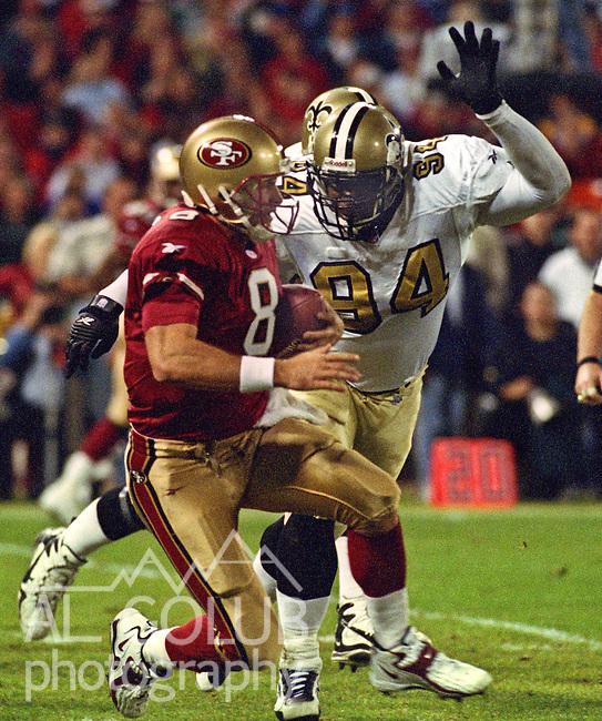 San Francisco 49ers vs. New Orleans Saints at Candlestick Park Sunday, November 22, 1998.  49ers beat Saints  31-20.  New Orleans Saints defensive end Joe Johnson (94) chases San Francisco 49ers quarterback Steve Young (8).