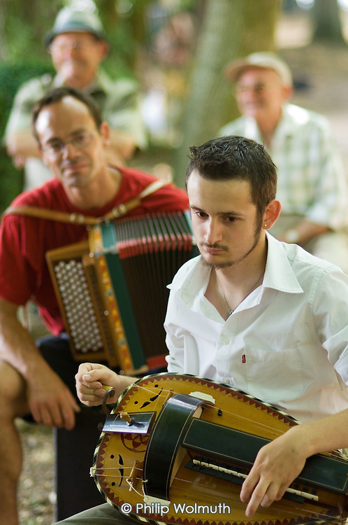 An accordionist and hurdy-gurdy player at the 31st International Festival of Luthiers and Maitres Sonneurs, in Saint Chartier, France.