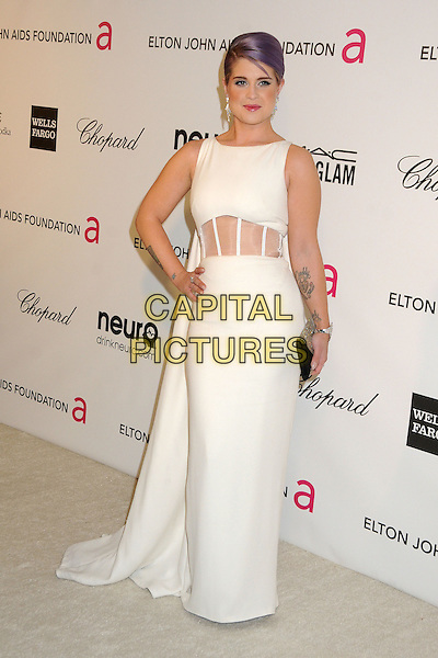 Kelly Osbourne.21st Annual Elton John Academy Awards Viewing Party held at West Hollywood Park, West Hollywood, California, USA..February 24th, 2013.oscars full length white sleeveless dress hand on hip sheer cape tattoos cut out panel waist black clutch bag.CAP/ADM/BP.©Byron Purvis/AdMedia/Capital Pictures.
