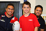 NELSON, NEW ZEALAND - July 26: Quentin MacDonald  and Jesse MacDonald with a young fan during the Tasman Makos Family Fun Day at TRU Players Room, Trafalgar Park July 26, 2015 in Nelson, New Zealand. (Photo by Marc Palmano/Shuttersport Limited)