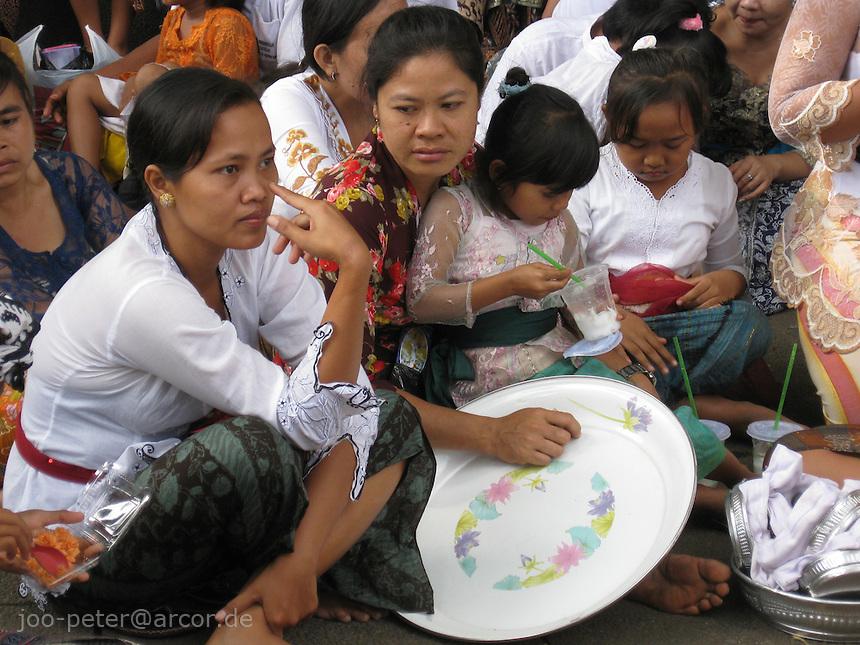 crowd watching cremation ceremonies in village Mas, Bali, archipelago Indonesia