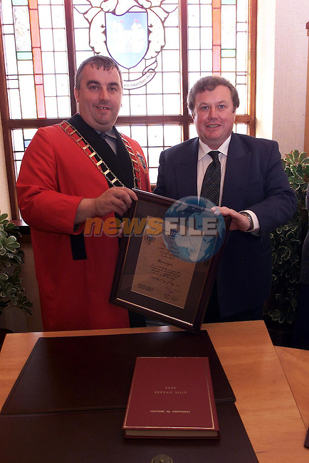 Seamus Lynch receives his civic award from Mayor Sean Collins.Picture: Fran Caffrey Newsfile