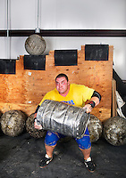 Tyler Stickle (cq) trains for a strongman competition at Shaw's gym in Frederick, Colorado, Saturday, September 21, 2013. <br /> <br /> Photo by Matt Nager