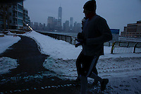 People run by the Hudson River shore in Jersey City , as winter storm hits the tri-state area causing significant delays at airports in the region. Last month was coldest February in New York City since 1869. Mar 01,2015. Kena Betancur/VIEWpress.
