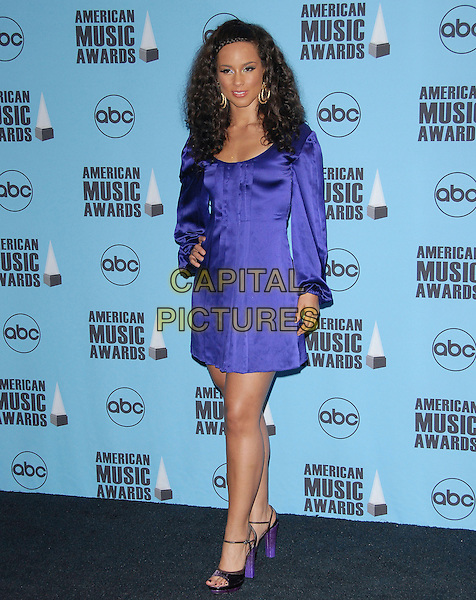 ALICIA KEYS.Attends The 35th Annual American Music Awards held at The Nokia Theater in Los Angeles, California, USA, November 18 2007.                                                                                    AMA AMA's full length purple dress silk satin Plait hair braid shoes sandals hand on hip.CAP/DVS.©Debbie VanStory/Capital Pictures