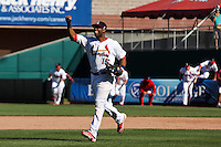 Xavier Scruggs (15) of the Springfield Cardinals runs towards the infield after the last out in a game against the Tulsa Drillers at Hammons Field on September 9, 2012 in Springfield, Missouri. (David Welker/Four Seam Images)