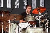 HAIM - drummer Dash Hutton - performing live on the Pyramid Stage on Day One at the 2013 Glastonbury Festival held at Pilton Farm Pilton Somerset UK - 28 Jun 2013.  Photo credit: George Chin/IconicPix