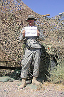 "11 September 2006: Jeff Des Jarlais, 1st Lieutenant, US Army, a 2002 Stanford graduate, is currently stationed in Iraq. He is pictured holding a ""Go Stanford Beat Navy"" banner."