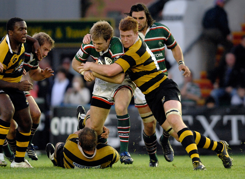 Photo: Richard Lane..Leicester Tigers A v London Wasps A. Guinness A League Final. 07/05/2007. .Tigers' Matt Cornwell is tackled by Wasps' John Hart and Hugo Ellis (rt).