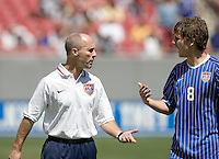 USA head coach Bob Bradley talks with his son, player Michael Bradley during an International Friendly between Ecuador and the USA at Raymond James Stadium, Tampa, Florida on Sunday, March 25, 2007. The USA won 3-1 behind a hat trick by Landon Donovan.