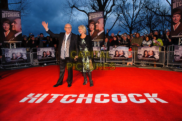 Sir Anthony Hopkins and Dame Helen Mirren.'Hitchcock' Film Premiere at the BFI Southbank, London, England..December 9th, 2012.full length black coat jacket green white floral print dress gloves grey gray paisley print scarf glasses hand arm waving .CAP/CJ.©Chris Joseph/Capital Pictures.