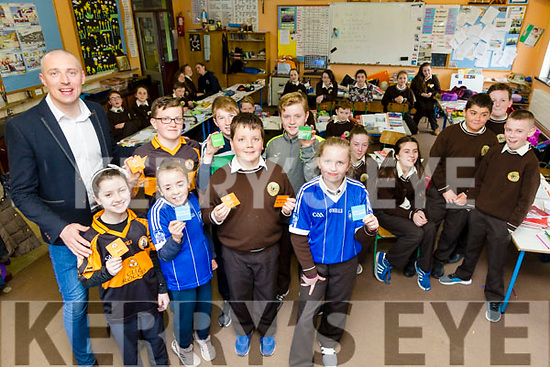 Gaelscoil Mhic Easmainn 5th class students have launched their JEP Junior Entrepreneur project 'Mi Magnets' fridge magnets with your local sports club logo on them. Austin Stacks having put in a order to commemorate their 100th anniversary. Pictured Austin Stacks and kerry star Kieran Donaghy with Doireann de Mordha, Tanisha Ni Odhrain, Ella Ni Chonchuir, Lucas Mac Gearailt, Shane O Ceallaigh, Brian o Domhnaill with students from 5th class