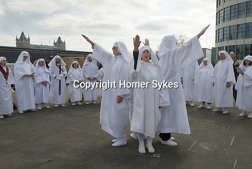 Druids perform a Spring Equinox ceremony at Tower Hill London. UK Annually March. Pointing in the direction of North, South,  East and West.