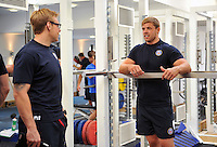 Dave Attwood has a word with Head Performance Analyst Darren Lewis in the gym. Bath Rugby pre-season training on July 16, 2013 at Farleigh House in Bath, England. Photo by: Patrick Khachfe/Onside Images