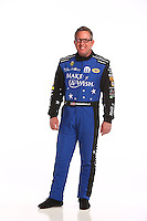 Jan 13, 2016; Brownsburg, IN, USA; NHRA funny car driver Tommy Johnson Jr poses for a photo during a portrait shoot at Don Schumacher Racing. Mandatory Credit: Mark J. Rebilas-USA TODAY Sports