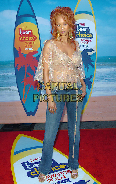 TYRA BANKS.At the 2004 Teen Choice Awards held at Uiversal Amphitheatre, Universal City, CA, USA,.8th August 2004..full length sheer see trough see thru shirt silver.**UK SALES ONLY**.Ref:-ADM.www.capitalpictures.com.sales@capitalpictures.com.©Capital Pictures.