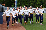 25 April 2016: Notre Dame players head to the dugout before the game. The University of North Carolina Tar Heels hosted the University of Notre Dame Fighting Irish at Anderson Stadium in Chapel Hill, North Carolina in a 2016 NCAA Division I softball game. UNC won the game 7-6.