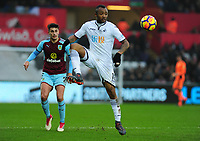Burnley's Matthew Lowton battles with Swansea City's Jordan Ayew<br /> <br /> Photographer Ashley Crowden/CameraSport<br /> <br /> The Premier League - Swansea City v Burnley - Saturday 10th February 2018 - Liberty Stadium - Swansea<br /> <br /> World Copyright &copy; 2018 CameraSport. All rights reserved. 43 Linden Ave. Countesthorpe. Leicester. England. LE8 5PG - Tel: +44 (0) 116 277 4147 - admin@camerasport.com - www.camerasport.com