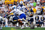FOXBORO, MA - MAY 28: Dylan Brown (14) of the Limestone Saints pushes Max Allen (39) of the Merrimack Warriors during the Division II Men's Lacrosse Championship held at Gillette Stadium on May 28, 2017 in Foxboro, Massachusetts. (Photo by Larry French/NCAA Photos via Getty Images)