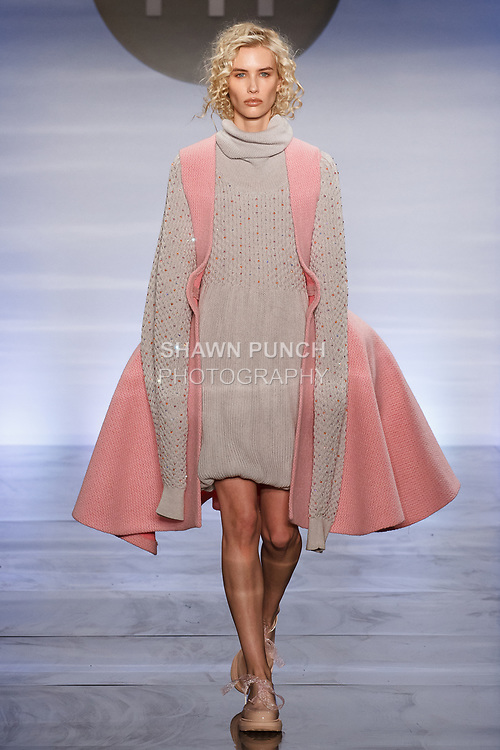 Model walks runway in an outfit by Marion Kunz, during the Future of Fashion 2017 runway show at the Fashion Institute of Technology on May 8, 2017.
