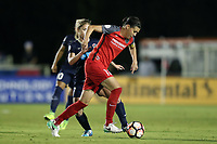 Cary, NC - Saturday April 22, 2017: Christine Sinclair (12) is defended by McCall Zerboni (behind) during a regular season National Women's Soccer League (NWSL) match between the North Carolina Courage and the Portland Thorns FC at Sahlen's Stadium at WakeMed Soccer Park.