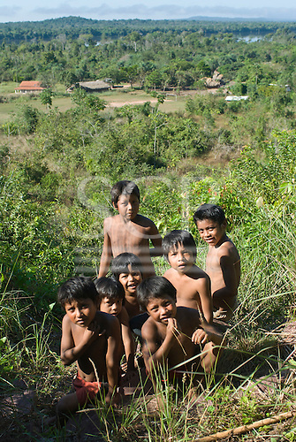 Mato Grosso State, Brazil. Aldeia Metuktire (Kayapo). Children with a view of the village from the top of the hill.