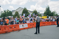 Fairfax,VA August 4 2018, USA: Police keep demonstrators on both sides of the gun control issue rally at the National headquarters of the National Rifle Association (NRA) in Fairfax, VA.  Dubbed  &quot;The March on the NRA&quot; protestors line the streets in fron the of headquarters.  DC.  <br /> CAP/MPI/PYL<br /> &copy;PYL/MPI/Capital Pictures