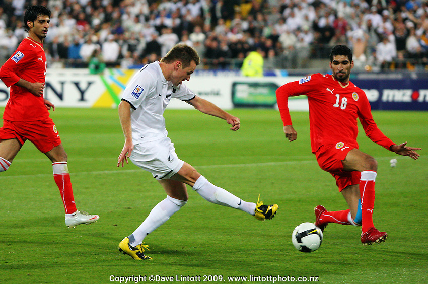 All Whites striker Shane Smeltz' shot is blocked by Sayed Mohamed Adnan during the second leg of the FIFA World Cup soccer qualifying play-off between New Zealand All Whites and Bahrain at Westpac Stadium, Wellington, New Zealand on Saturday, 14 November 2009. Photo: Dave Lintott / lintottphoto.co.nz