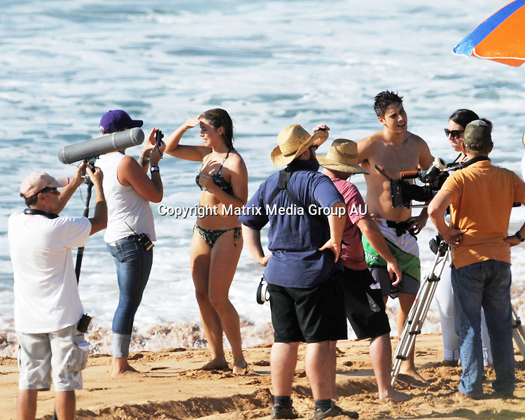 1 APRIL 2014 SYDNEY AUSTRALIA<br /> <br /> EXCLUSIVE PICTURES<br /> <br /> Pictured, Home and Away actors, Lincoln Younes and english love interest, Hannah Britland on the &quot;set&quot; at Palm Beach (Summer Bay) .
