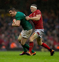 Ireland's Johnny Sexton is tackled by Wales' Hadleigh Parkes<br /> <br /> Photographer Bob Bradford/CameraSport<br /> <br /> Guinness Six Nations Championship - Wales v Ireland - Saturday 16th March 2019 - Principality Stadium - Cardiff<br /> <br /> World Copyright © 2019 CameraSport. All rights reserved. 43 Linden Ave. Countesthorpe. Leicester. England. LE8 5PG - Tel: +44 (0) 116 277 4147 - admin@camerasport.com - www.camerasport.com