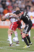 New York Red Bulls defender Markus Holgersson (5) shields the ball from D.C. United midfielder Chris Pontius (13) The New York Red Bulls tied D.C. United 2-2 at RFK Stadium, Wednesday August 29, 2012.