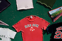 A street vendor sells Boston Red Sox souvenirs and shirts to fans outside Fenway Park during the 2011 Boston Red Sox season opener in Boston, Massachusetts, USA.