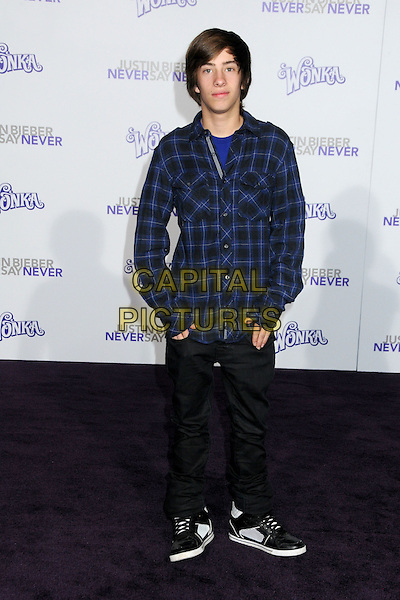 "JIMMY BENNETT.""Justin Bieber: Never Say Never"" Los Angeles Premiere held at Nokia Theater L.A. Live, Los Angeles, California, USA..February 8th, 2011.full length black jeans denim hands in pockets blue check shirt.CAP/ADM/BP.©Byron Purvis/AdMedia/Capital Pictures."