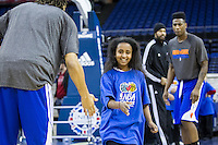 16.01.2013 London, England. New York Knicks point guard Iman Shumpert (21) and  New York Knicks forward Chris Copeland (14) running basketball drills with youngsters as part of the NBA Cares outreach programme ahead of the NBA London Live 2013 game between the Detroit Pistons and the New York Knicks from The O2 Arena